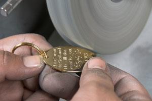 jeweler using a benchtop grinder