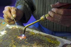 jeweler using solder flux